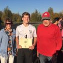 Our firstborn grandson receives the Rotary Club's Outstanding Athlete of the month award after his soccer game.